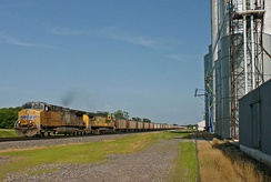 Two UP AC4400CWs, including an ex-CNW unit, lead a typical empty coal train west at Belvidere, Nebraska in July 2015