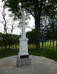 A monument marks the grave of Father Marquette, where he was buried next to the St. Ignace Mission, now used as the Museum of Ojibway Culture.