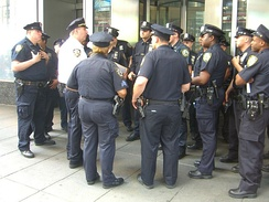 A lieutenant (white shirt) debriefing officers at Times Square in May 2010.