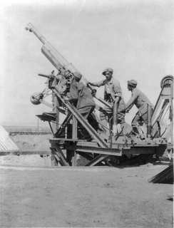French gunners with 75 mm anti-aircraft gun in Thessaloniki.