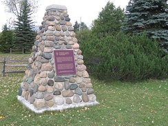 Plaques affixed to cairns were initially used to mark National Historic Sites, such as this one at Glengarry Landing in Ontario