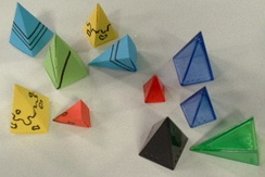 A selection of commercially-made plastic Icehouse pieces, and home-made paper pyramids