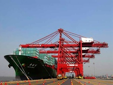 The cargo of a container ship from East Asia being unloaded at the Jawaharlal Nehru Port in Navi Mumbai, India. Increasing economic integration of Asian countries has also brought them closer politically.