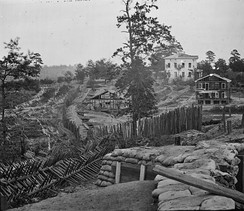 Palisades and chevaux de frise in front of the Potter (or Pondor) House, Atlanta, Georgia, 1864