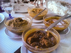 Goan pork vindalho served alongside other Portuguese-Goan dishes