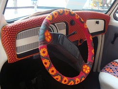 Cheerful steering wheel cover on a two-spoke Volkswagen Beetle steering wheel