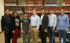 A group of Wikimedians of the Wikimedia DC chapter at the 2013 DC Wikimedia annual meeting standing in front of the Encyclopædia Britannica (back left) at the US National Archives