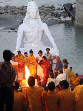 Shiva (above) is the primary deity of Shaivism. Ritual at Muni ki Reti, Rishikesh
