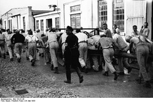 Prisoners in a Nazi concentration camp doing forced labour.