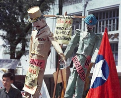 Effigies of Charles de Gaulle and Hồ Chí Minh are hanged by students during a demonstration in Saigon, July 1964, observing the tenth anniversary of the July 1954 Geneva Agreements