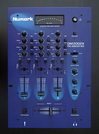 A Numark DM2002X Pro Master DJ mixer. This three channel mixer can have up to three input sound sources. The gain control knobs and equalization control knobs allow the volume and tone of each sound source to be adjusted. The vertical faders allow for further adjustment of the volume of each sound source. The horizontally-mounted crossfader enables the DJ to smoothly transition from a song on one sound source to a song from a different sound source.