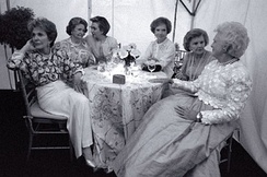 "First ladies (from left to right) Nancy Reagan, Lady Bird Johnson, Hillary Clinton, Rosalynn Carter, Betty Ford, and Barbara Bush at the ""National Garden Gala, A Tribute to America's First Ladies"", May 11, 1994. Jacqueline Kennedy Onassis, absent due to illness, died a week after this photograph was taken."
