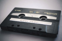 "A compact audio cassette mixtape with a handwritten label: ""Funky Stuff"""