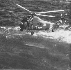 A U.S. Navy HSS-1 with dipping sonar deployed, in 1960.