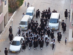 Hasidim walk to the synagogue, Rehovot, Israel.