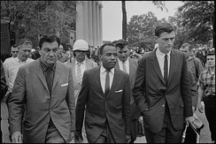 James Meredith walking to class accompanied by a U.S. Marshal and a Justice Department official