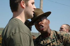 A Drill Instructor yells at a Delayed Entry Program poolee.