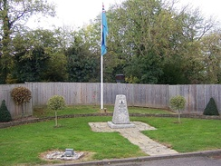 A memorial to the No. 11 Group underground operations room alongside the RAF ensign at RAF Uxbridge.