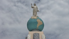 The iconic statue of Christ on the globe sphere of planet earth is part of the Monumento al Divino Salvador del Mundo (Monument to the Divine Savior of the world) on Plaza El Salvador del Mundo (The Savior of the World Plaza), a landmark located in the country's capital, San Salvador.
