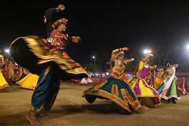 Women and men performing Garba as part of Navaratri celebrations in the city of Ahmedabad