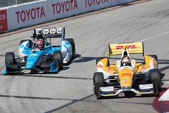 Hunter-Reay (right) competing with Simon Pagenaud at the 2012 Toyota Grand Prix of Long Beach on the Streets of Long Beach.