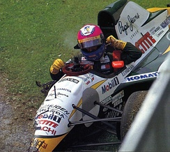 Pedro Lamy leaving his wrecked Lotus 107C after hitting JJ Lehto's stalled Benetton B194, causing an early safety car.