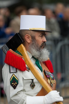 "The sappers (""sapeurs"") of the French Foreign Legion traditionally sport large beards, wear leather aprons and gloves in their ceremonial dress, and carry axes."