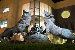 Sculpture of Los Lobos de Loyola in front of Gleeson Library