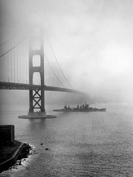 The USS San Francisco steams under the Golden Gate Bridge in 1942, during World War II.