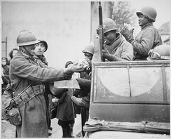 French Moroccan and African-American troops link up at Rouffach, Alsace during the 1945 Pocket of Colmar.