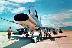 Ground crew prepares an F-100 of the Colorado Air National Guard's 120th Tactical Fighter Squadron for combat mission at Phan Rang Air Base, South Vietnam, 1968