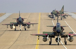 One TA-4SU leading Two A-4SU Super Skyhawks on the flight line at Korat AB, Thailand, during Exercise Cope Tiger '02.