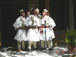 Albanian polyphonic folk group wearing qeleshe and fustanella in Skrapar.