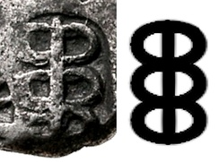 Caduceus symbol on a punch-marked coin of king Ashoka in India, third to second century BC