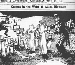A 13 May 1942 editorial cartoon from the Japanese English-language newspaper Japan Times & Advertiser depicts a dejected Uncle Sam joining John Bull in erecting grave markers for Allied ships which Japan had sunk, or claimed to have sunk, at Coral Sea and elsewhere.