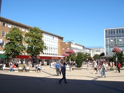 Queen's Square in the central shopping area, looking towards the bandstand, The Body Shop, Marks & Spencer and the former Woolworths store