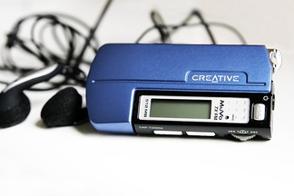 A Creative MuVo (2002–2009), a small solid-state MP3 player in a USB flash drive form-factor