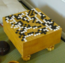 Go is an abstract strategy board game for two players, in which the aim is to surround more territory than the opponent and was invented in China more than 2,500 years ago.
