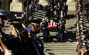 Honor guards carry the casket of former President Gerald R. Ford out of the United States Capitol Building in Washington, D.C., January 2, 2007 en route to Washington's National Cathedral for a funeral service.