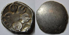 A monetary silver coin of the satrapy of Gandhara about 500–400 BC. Obv: Gandhara symbol representing 6 weapons with one point between two weapons; At the bottom of the point, a hollow moon. Rev: Empty. Dimensions: 14 mm Weight: 1.4 g.