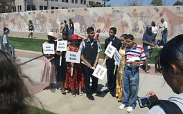 Inglewood High School students portrayed historic characters when the restored mural behind them was dedicated in August 2007.