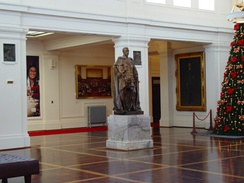 A statue of King George V looks over King's Hall in Old Parliament House, Canberra