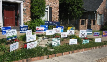 "New Orleans house with a collection of signs for all the mayoral candidates, with the comment ""More candidates than voters?"""
