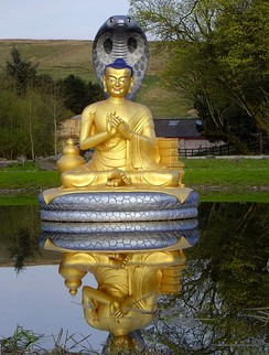Golden statue of Nagarjuna at Samye Ling Monastery.