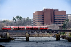 An O-Train crossing the Rideau River. The O-Train is a light rail public transportation service provided by OC Transpo.