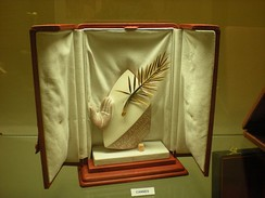 "The Palme d'Or (""Golden Palm""), the most prestigious award given out at Cannes Film Festival."
