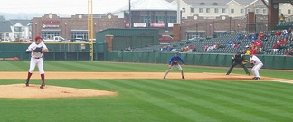Arkansas's Mark Bolsinger prepares to throw to first base to try to pick off Florida's Avery Barnes in 2009.