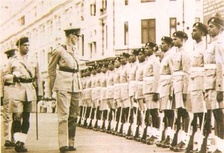 Brigadier James Sinclair, Earl of Caithness inspecting a guard of honour wearing khaki drill