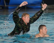 Second Phase A BUD/S instructor attacks a trainee in the pool to simulate a combative drowning victim.