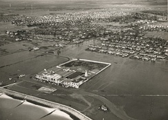 The flooded sea front, amusements and residential areas in 1953